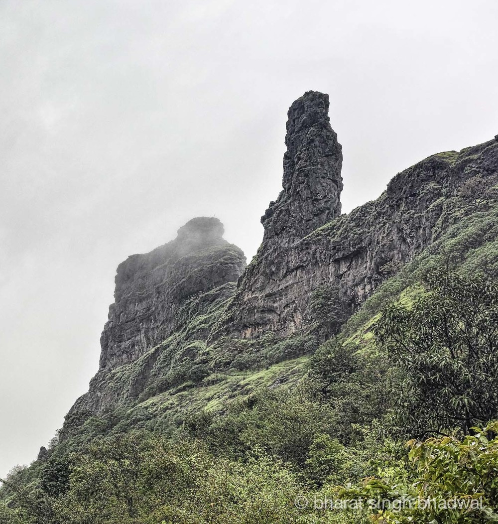 Irshalgad pinnacle draped in clouds