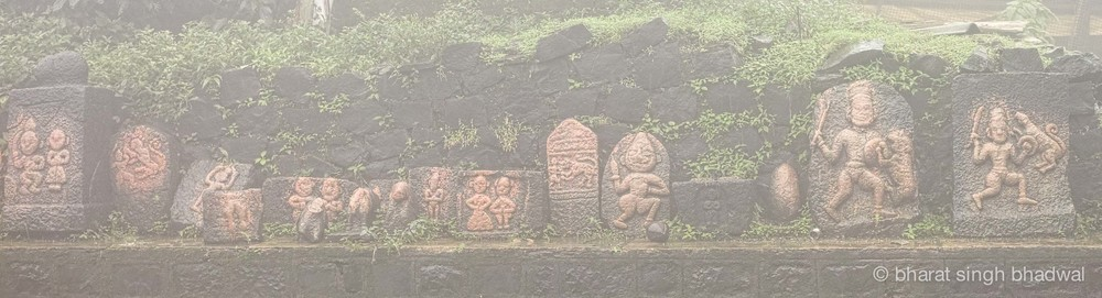 Historical idols at Kamalaja temple, viewed through the mist