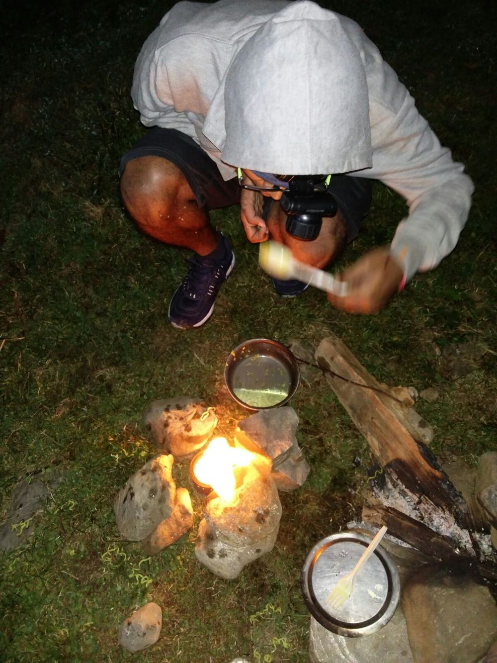 Nikhil and friends using an alcohol stove in the field  (on Brighu Lake trek)