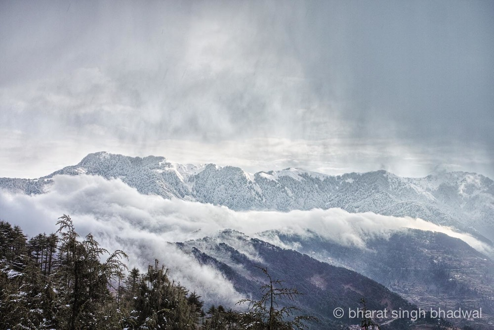Shivgarh ridge through a wall of clouds and snow