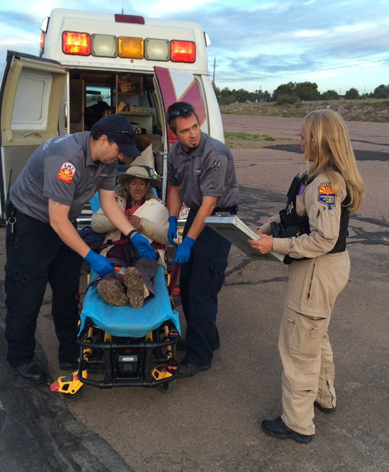 This photo was taken, Saturday, April 9, 2016, and provided by Arizona Department of Public Safety shows an ambulance taking Ann Rodgers, 72, to safety after she was lost in the forest for nine days.