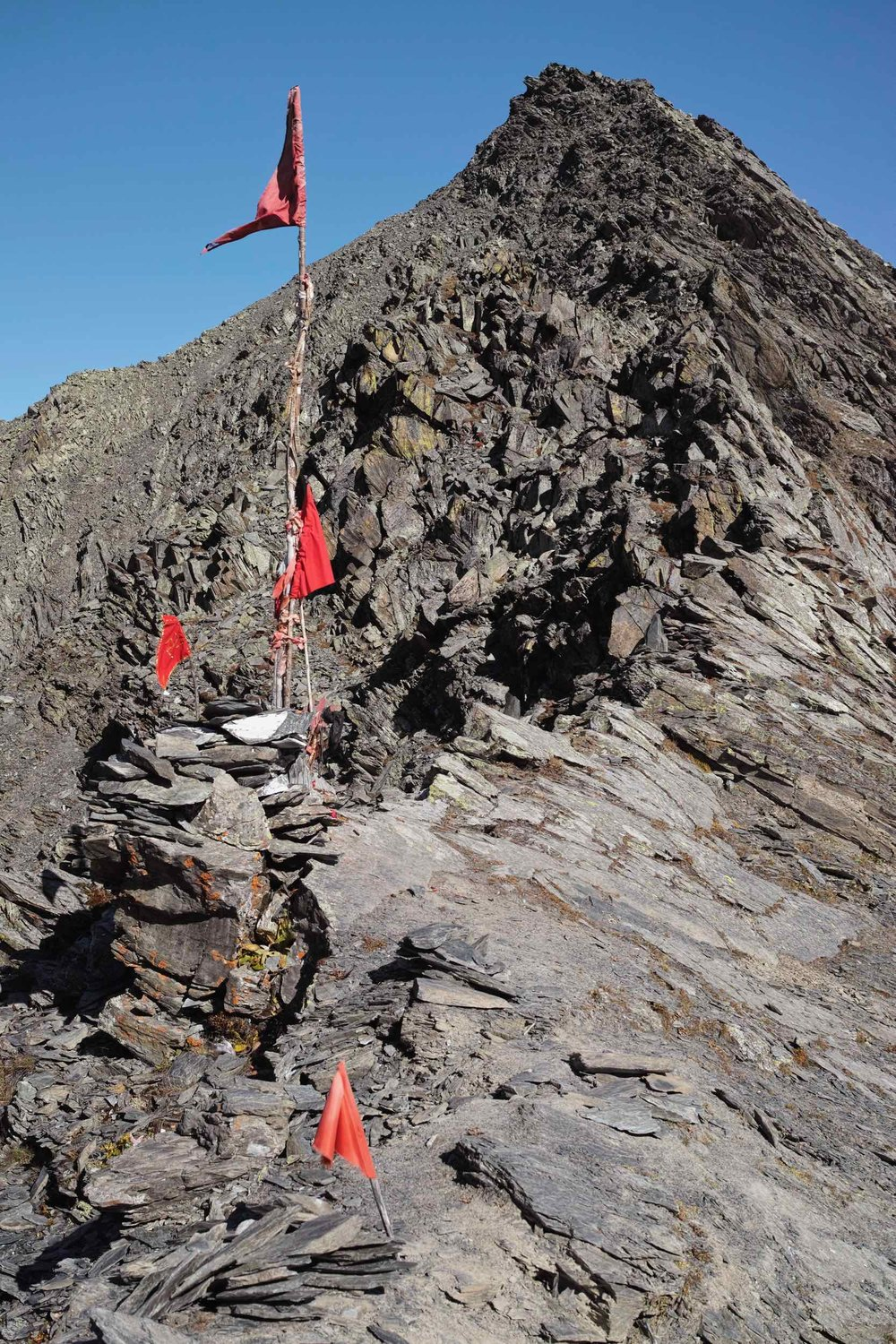 Kalah Pass is decked in a few prayer flags. The major sharp ridge marks the 4624m mountain pass