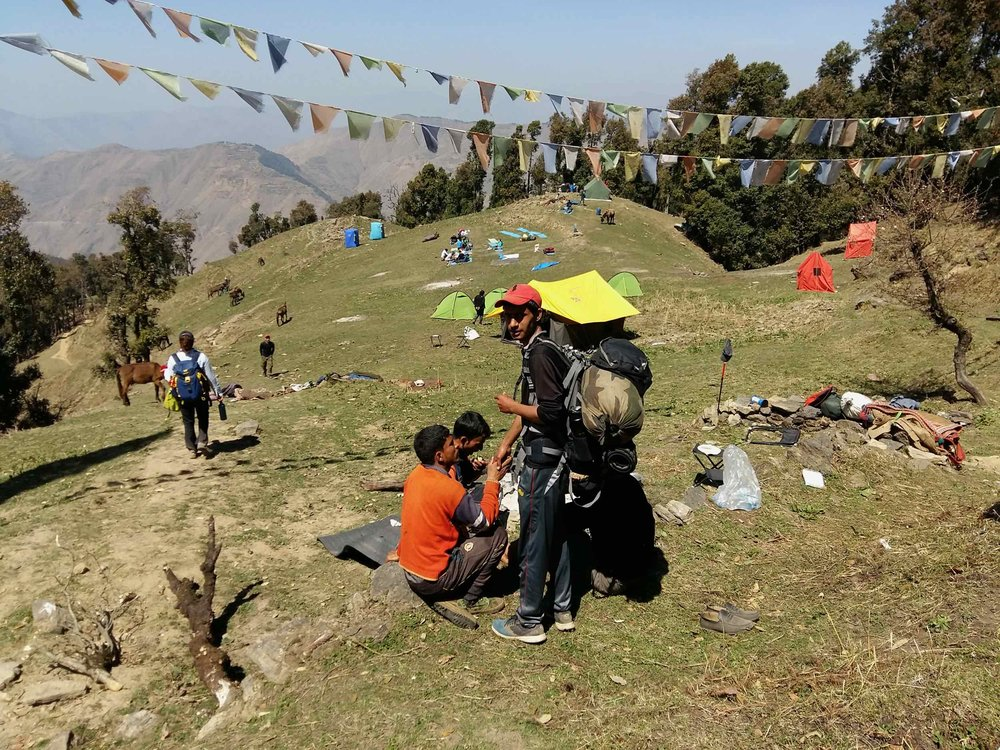 "Base Camp at Nag Tibba on a ""less"" busy weekend. You would not want to be here on a ""regular"" weekend. The large tents are toilet tents or staff tents put up by trekking operators"
