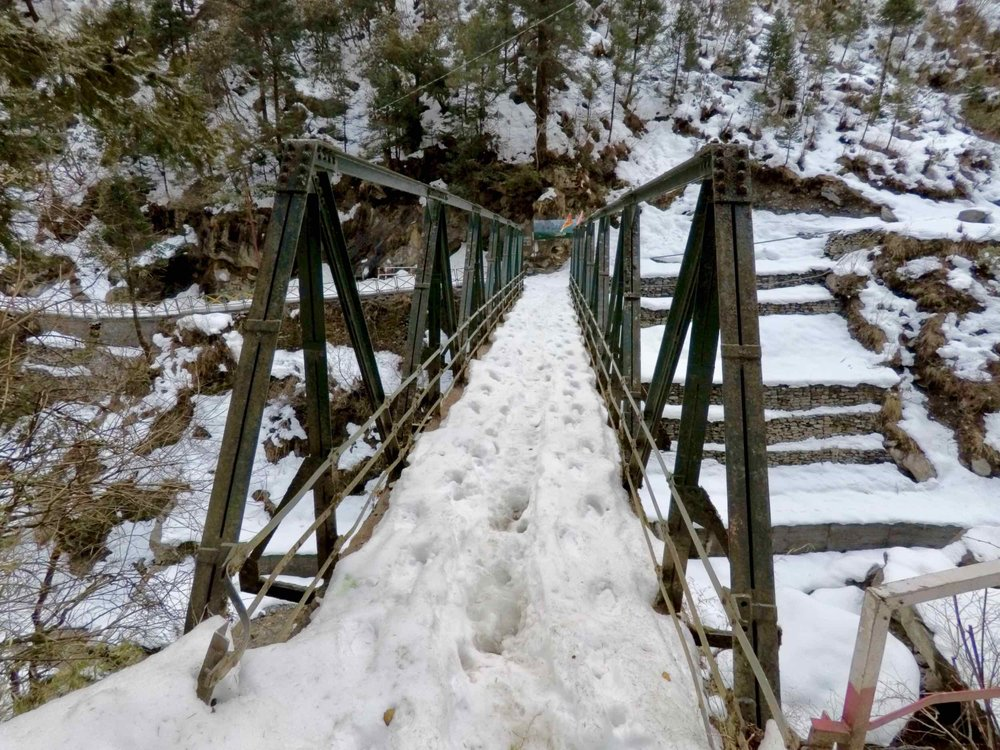 This steel girder bridge marks the halfway point on the Janki Chatti - Yamunotri trail. Though the going gets much tougher after this with heavier snow and steeper switchbacks.