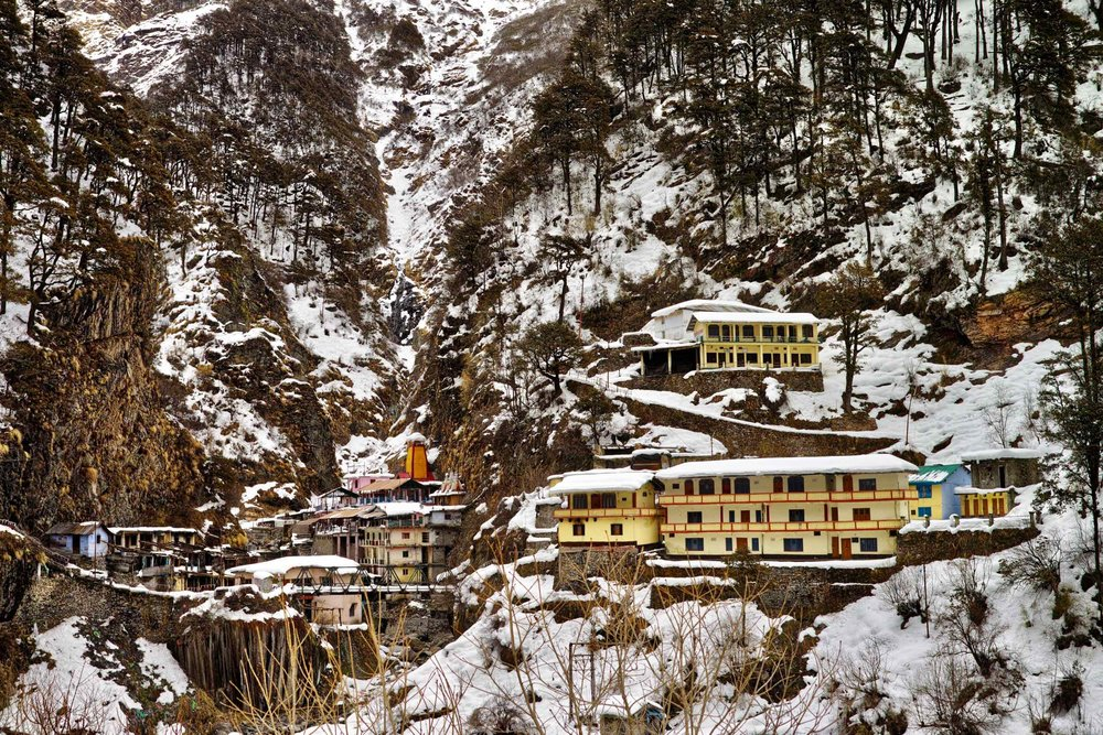Yamunotri temple (orange building with a snow cap) and ashrams and dharamshalas in March 2017
