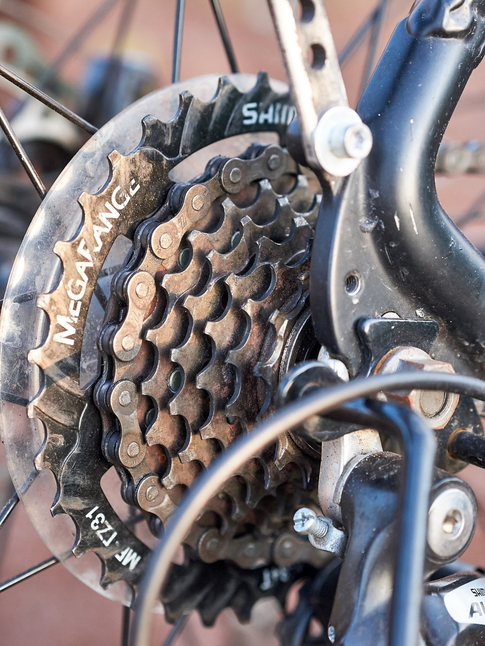 "I swapped the default Shimano Altus 7 speed freewheel with Shimano's ""MegaRange"" 14-34, 7 speed freewheel. It gave me a much lower (34 tooth) gear for those steep inclines."