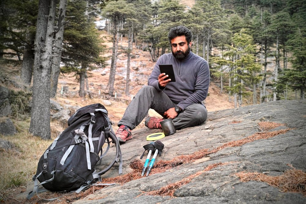 Bharat relaxes with his Kindle after a day's hike