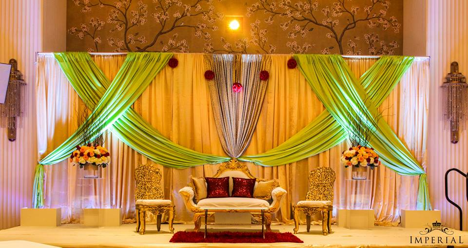 A minty mix pistachio green and gold imperial decor for Background decoration for indian wedding
