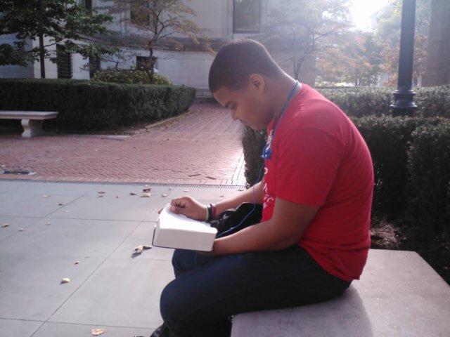 Edgar studying his scriptures at school.