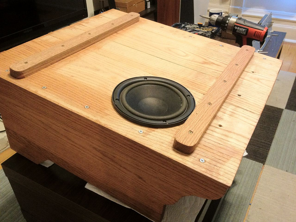 A shot of the bottom, including subwoofer and cross-braces/feet