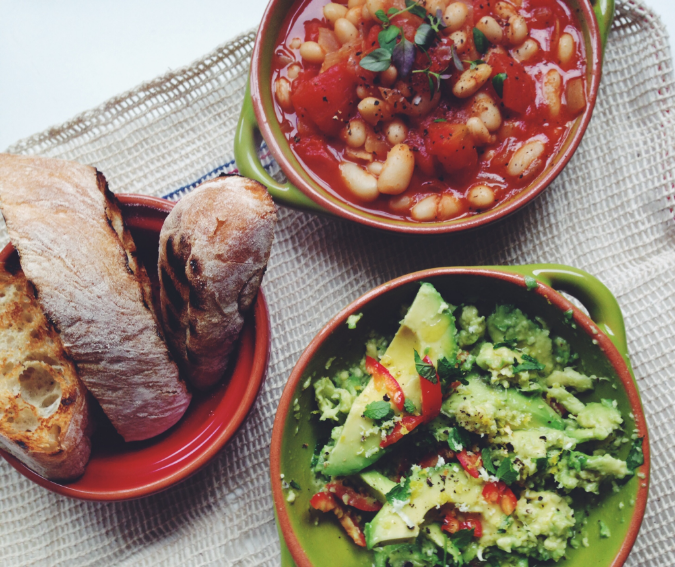 Homemade baked beans with smashed avocado