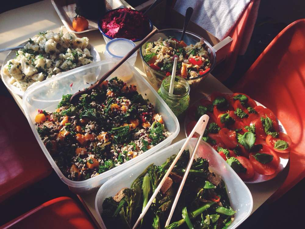 Anti clockwise: Kale, butternut squash, lentil and pomegranate salad, tenderstem broccoli, mangetout, chilli, sesame and tofu salad, tomatoes and pesto, roasted vegetables and orzo, beetroot hummus and cauliflower, almonds, vegan mayonnaise and parsley salad.