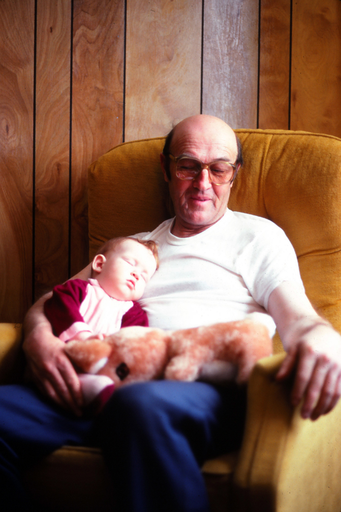 Albert Doyle and Baby Angie, Ingonish NS. Photographed by Douglas Arsenault