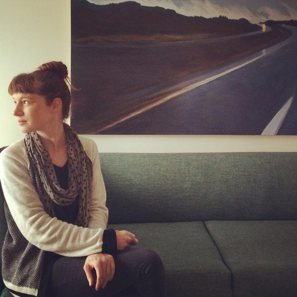 Rebecca took this photo of me during an interview with Erin Eileen Casey in the common area of my new studio space.
