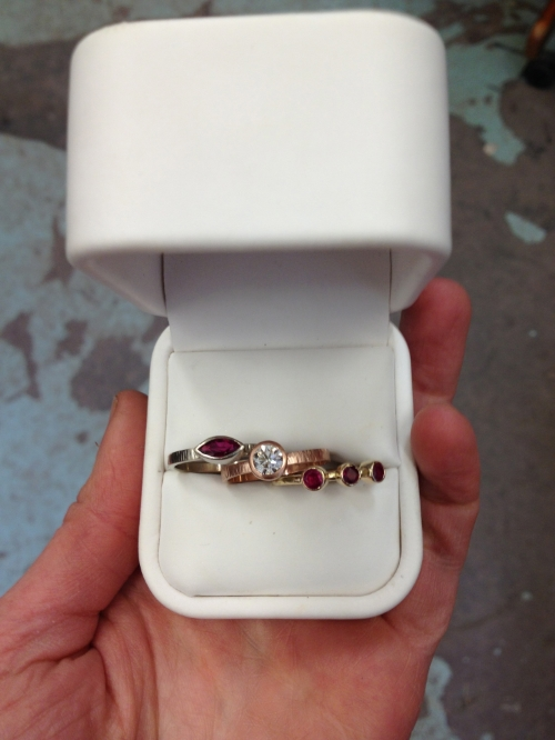 Custom stacking rings: White gold/ruby, rose gold/diamond, yellow gold/ruby