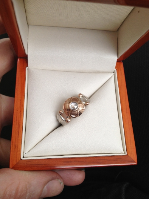 Custom rose gold and sterling silver engagement ring with a rose cut diamond.