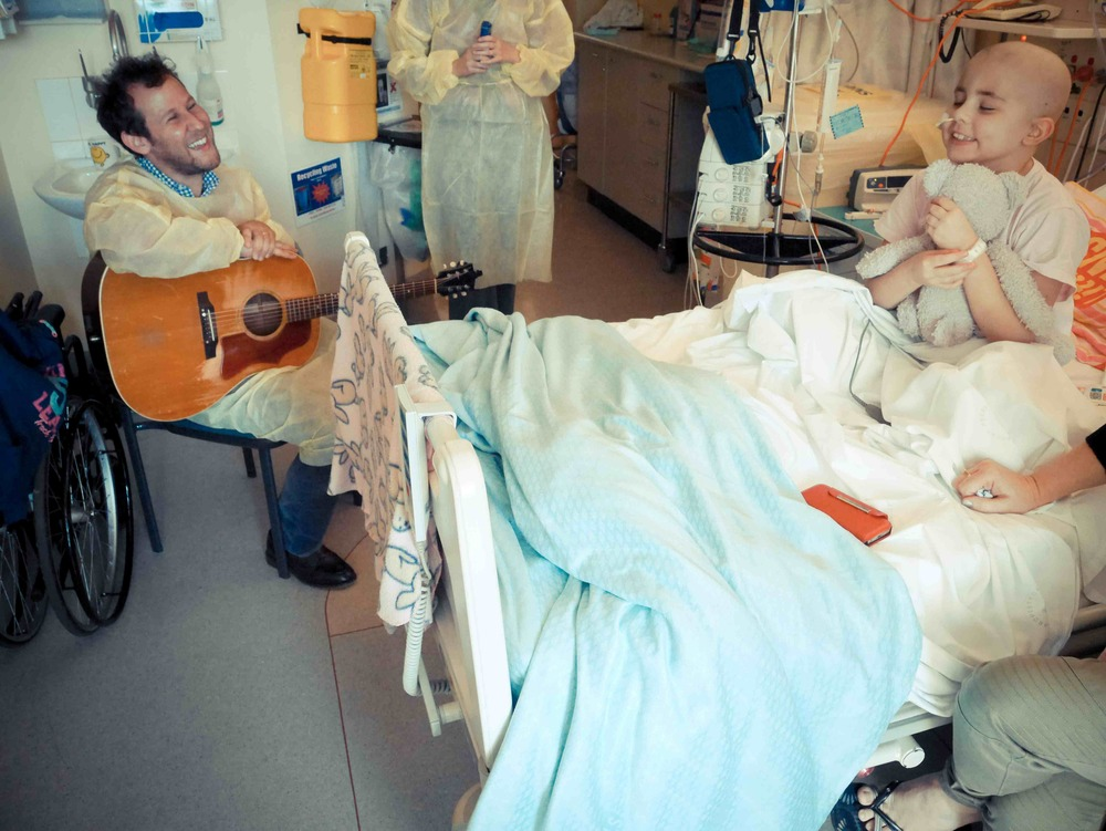 Australia's leading musician, Ben Lee playing at the bedside
