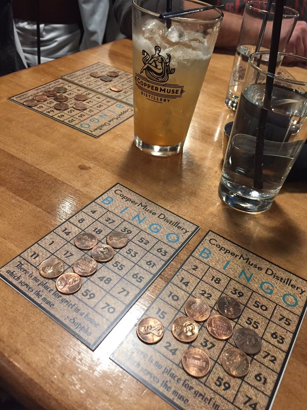 Ready to Play - Two BINGO cardsCopper pennies to mark your numbersCocktail & Food in hand