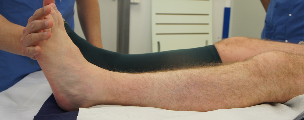 Clinical photograph, with the knee extended, ankle movement is restricted indicating a tight calf muscle.