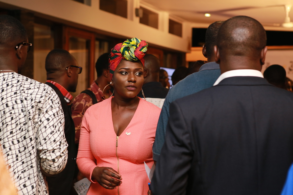 Dentaa engaging with invited guests.