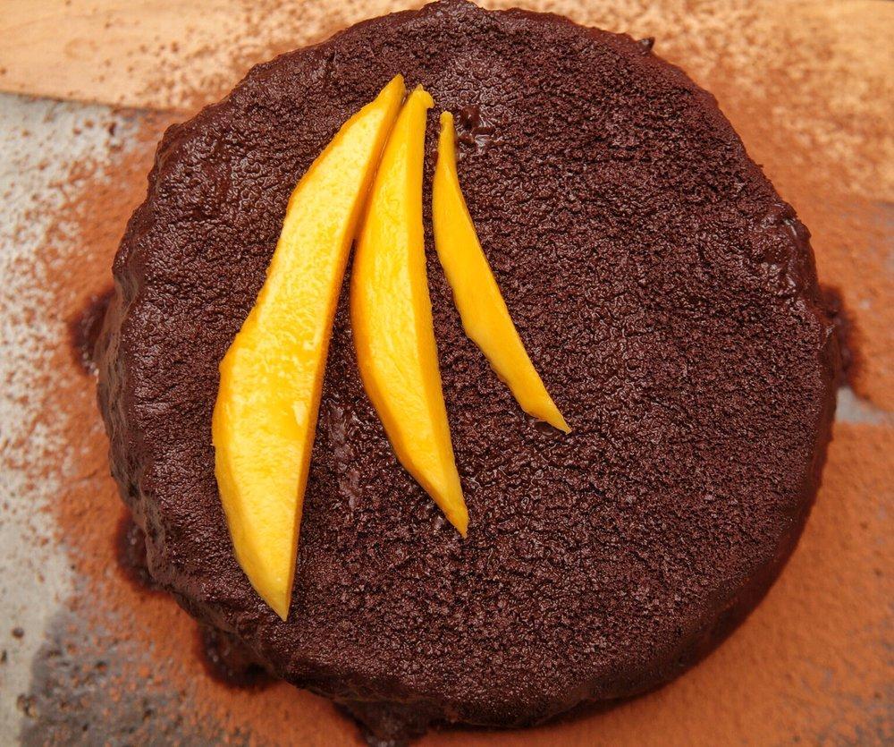 Garnished with fresh mango slices
