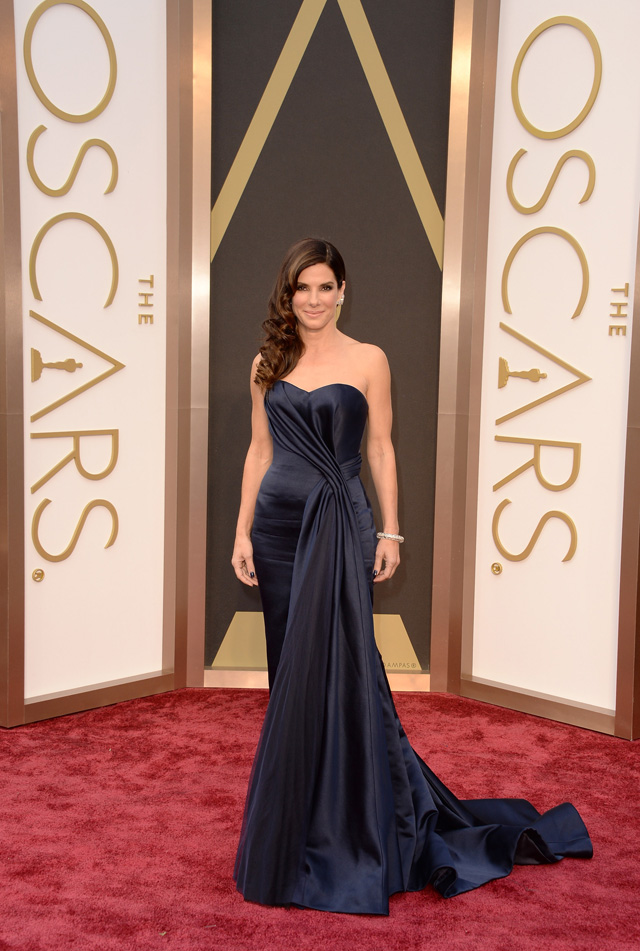 Sandra Bullock is absolutely gorgeous in this deep blue gown by Alexander McQueen.