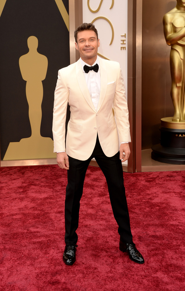 Ryan Seacrest wore a creamed colored Burberry jacket with the classic black slacks, and we approve.