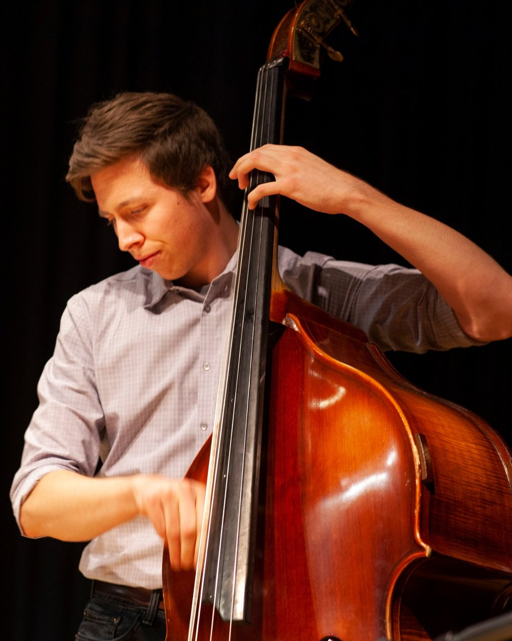 Eli Broxham - Eli makes Chicago his home and performs with a wide variety of ensembles including traditional and progressive bluegrass, old-time, western swing, gypsy jazz, country, rock and roll, and Latin folk.Eli graduated from DePaul University in 2016 with a degree in Bass Performance and uses his classical training, melded with his love of folk styles, to push the boundaries of the bassist's role in an ensemble.You can find him playing his own music and other's at venues all over the city ranging from Cole's bar, to Fitzgerald's, The Old Town School of Folk Music, City Winery, and even Symphony Center.