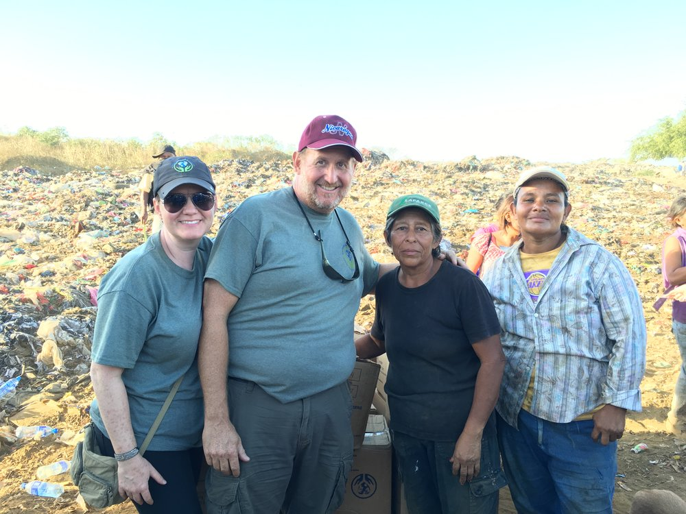 Suzanne & Jeffrey Yoh (pictured left) visit a trash dump in Nicaragua to distribute food to the hungry locals.
