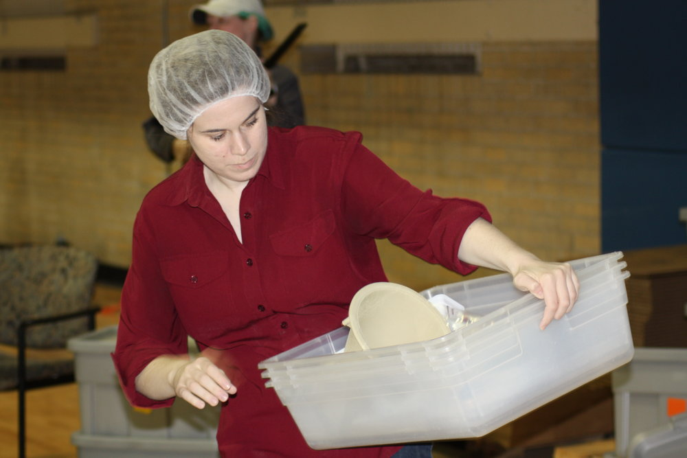 Amy Whisenand helps at our Servants with a Heart meal packing event.