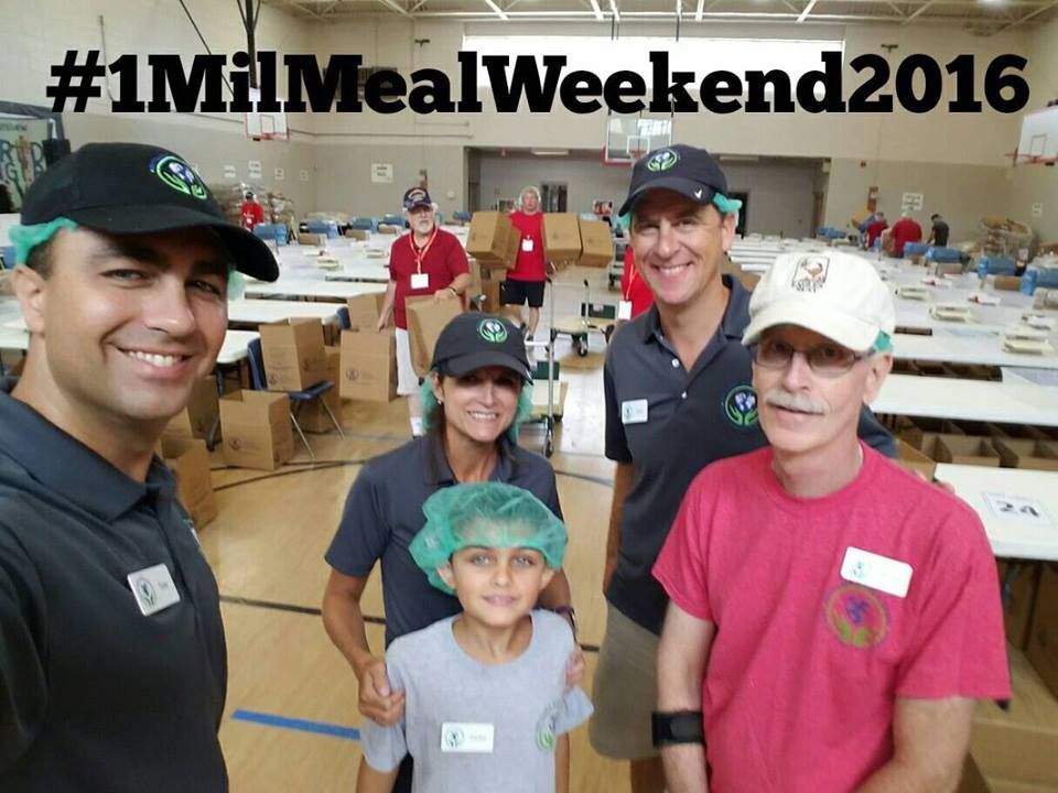Jeff Wilson (far right) packing the one millionth meal in 2016.