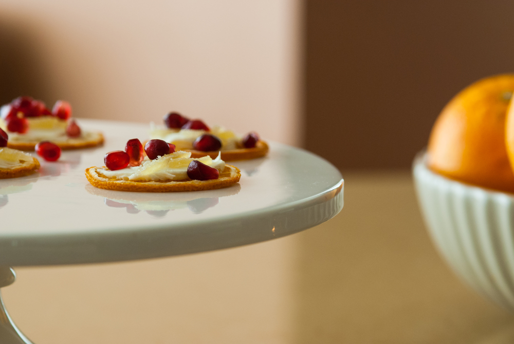s&c orange paired with mascarpone cheese, slivers of candied ginger and pomegranate