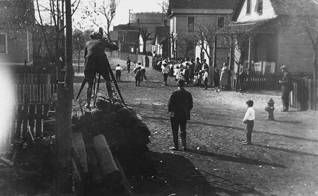 1923 Howard Cress shooting Community Fund movie in Lowertown near Thirteenth Street, St. Paul. Lowertown.jpeg