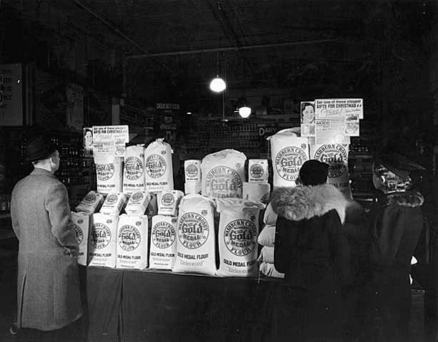 1935 Display of flour at Andrew Schoch Grocery, Seventh and Broadway Lowertown.jpg