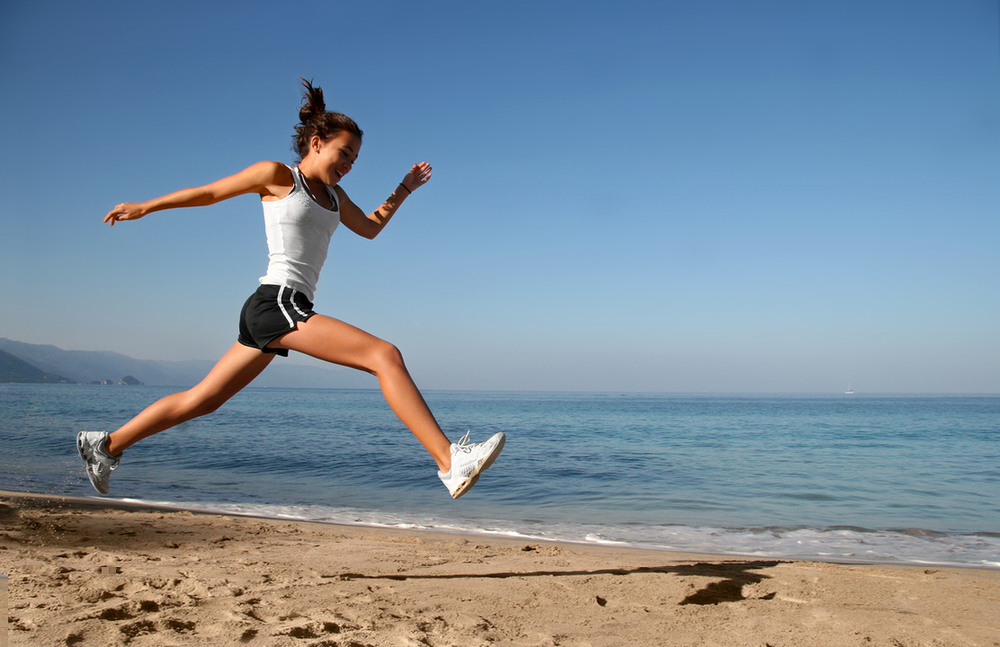 Woman_jumping_beach.jpg