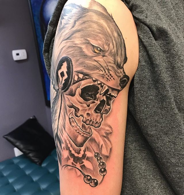 Little black and grey action with the skull and wolf head dress . • • • #blackandgreytattoo #wolftattoo #skulltattoo #nativeamericantattoo #instattoo #instagood #tatuaje #calavera #tatuajes #followforfollowback