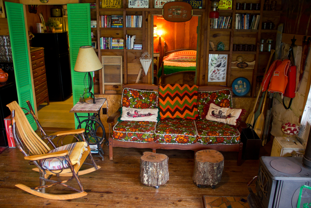 The main room with a window peeking back into the main bedroom (by me)