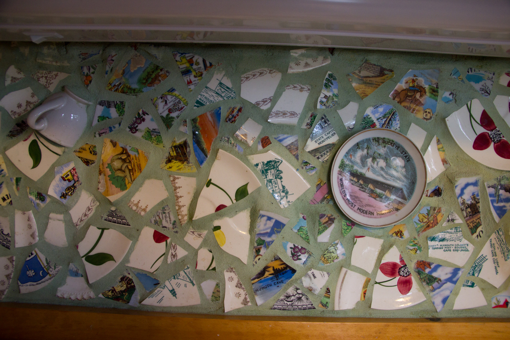 Close-up of the backsplash (by me). It's a mosaic of old plates and cups, featuring some really cool souvenir plates!