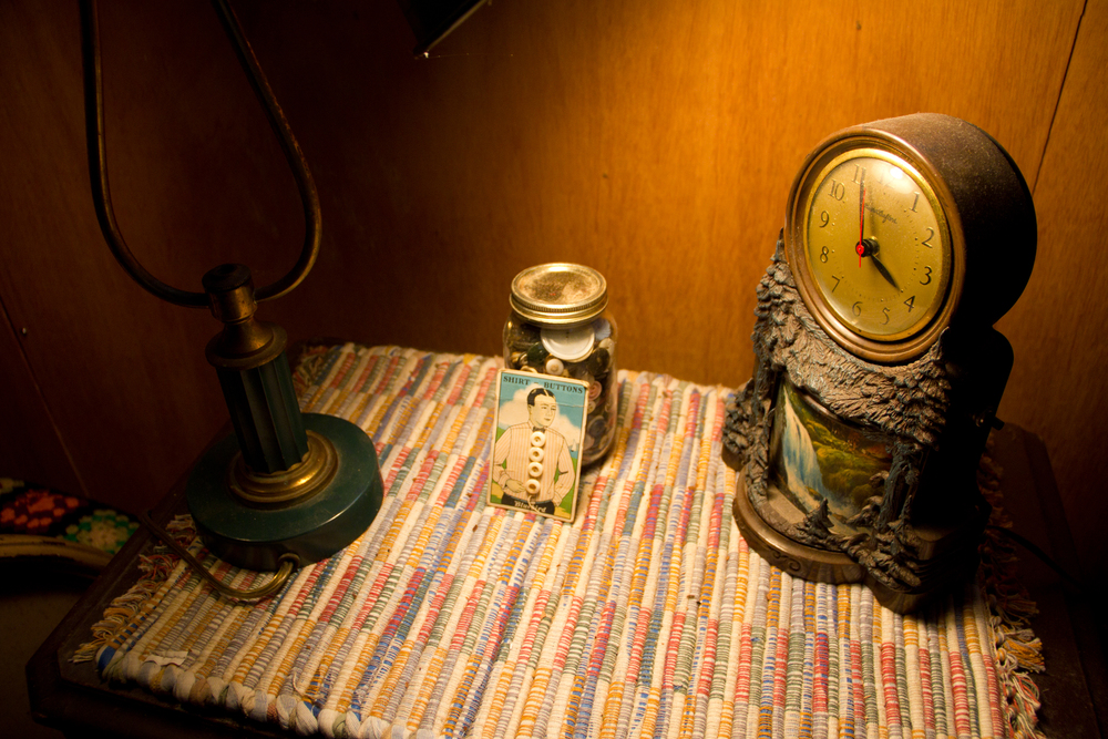A bedside table with an amazing souvenir clock (by me)