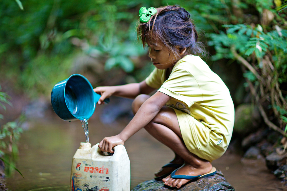 K'mu girl collects water - Luang Prabang