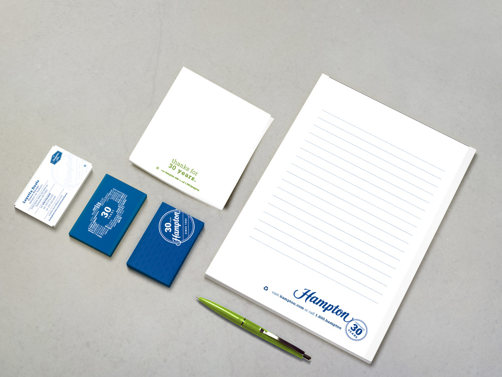 Meeting room notepad, in-room notepad and business cards featuring the Hampton 30th Anniversary Refresh