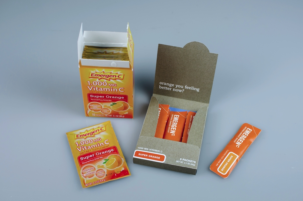 The existing Emergen-C packaging compared to our team's redesigned packaging