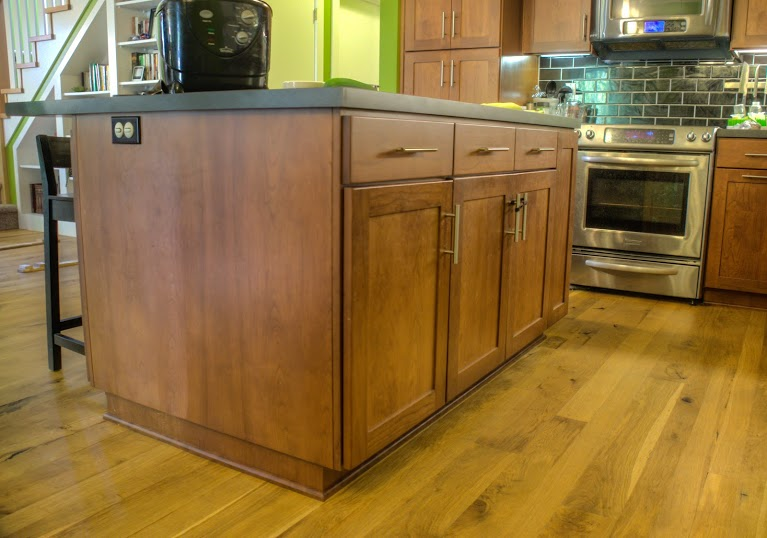 A cute kitchen with a large island and Oregon White Oak floors.