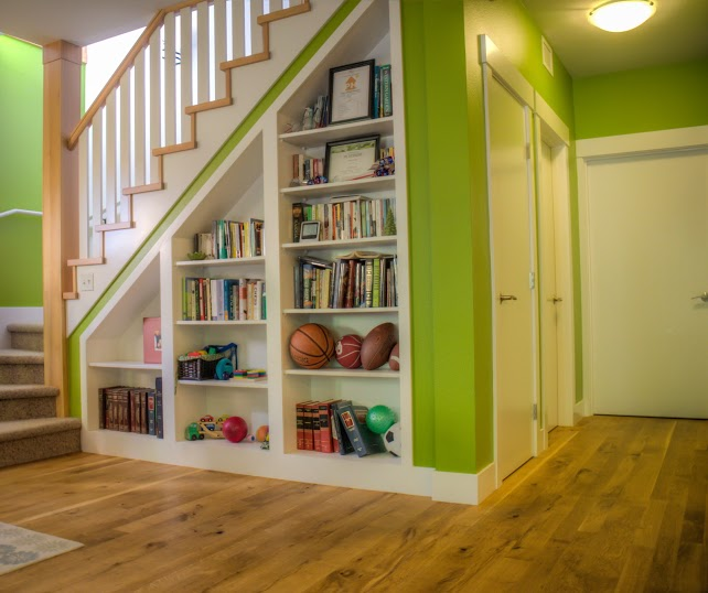 An entry hallway with bright green walls and Oregon White Oak floors.