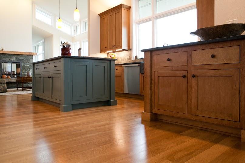 Two kitchen islands and premium oak flooring.