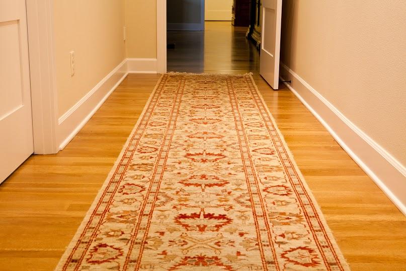 Woven rug on top of Zena's premium oak flooring