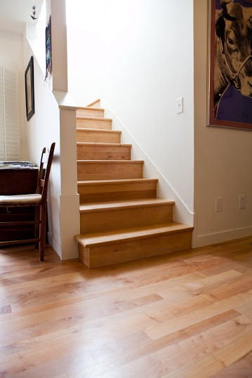 Zena Forest Products also provides stairs that match the flooring. This picture shows a set of maple stairs.