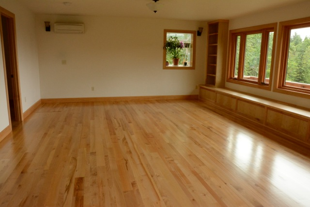 A gorgeous maple floor with lots of natural light.