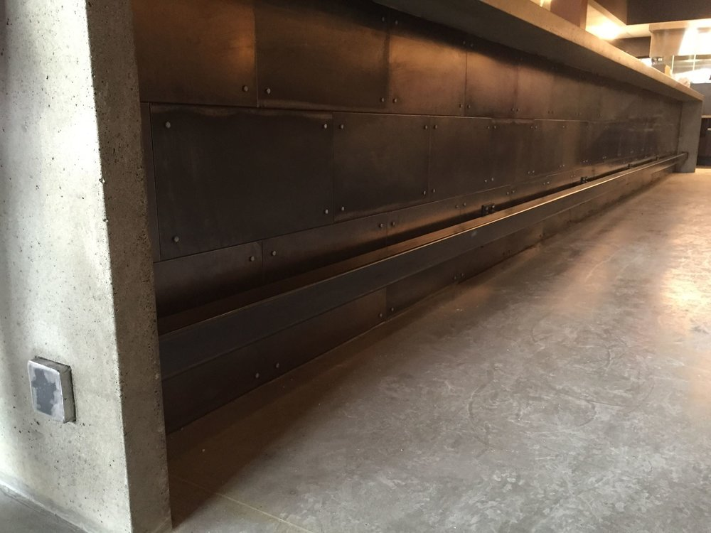 concrete bar waterfall ends steel panels steel footrail.jpg