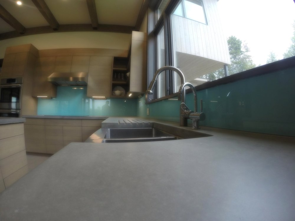 Concrete Countertops and Painted Glass Backsplash Stowe Vermont.jpg